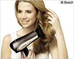 Seidig glänzendes Haar durch negativ geladene Teilchen in der Föhn-Luft?
