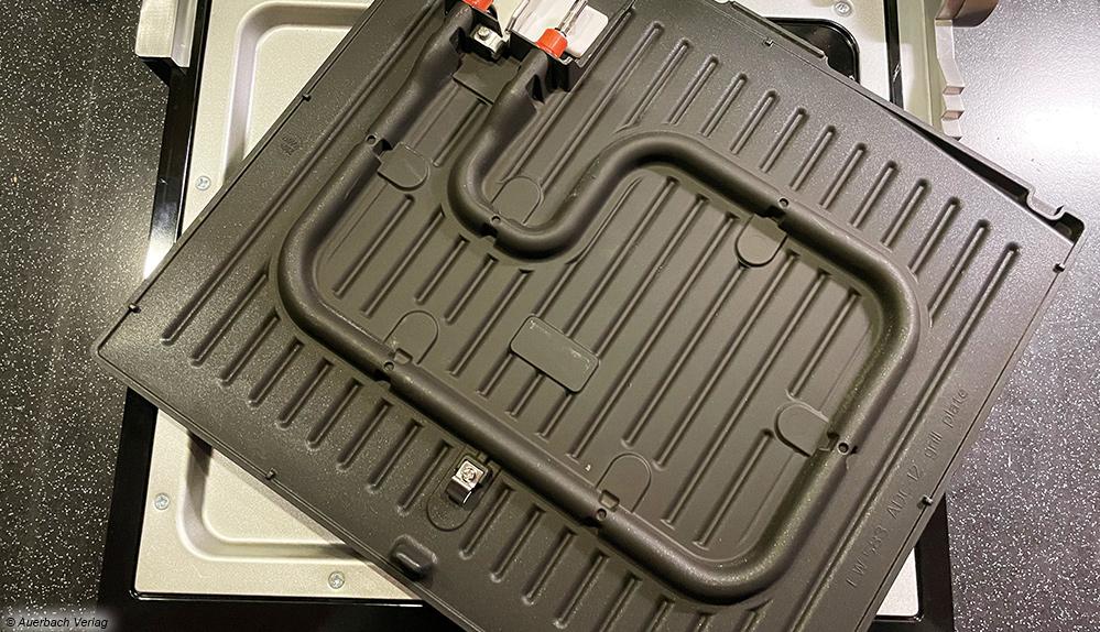 Die Heizelemente sind direkt an den Unterseiten der Grillplatten integriert und gewährleisten eine optimale Wärmeübertragung